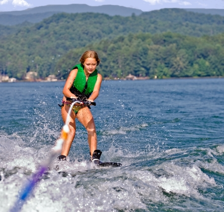 water skiing: Girl on skis getting ready to do a trick  Stock Photo