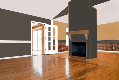 An empty living area with a fireplace.  Zdjęcie Seryjne
