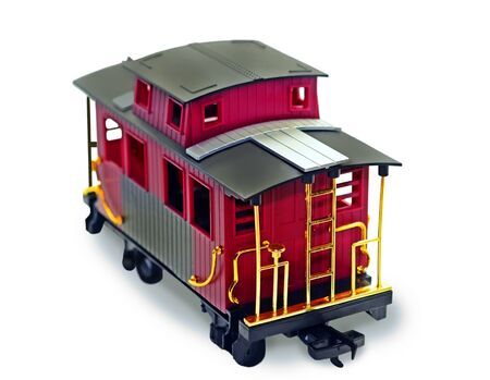 caboose: A bright plastic toy caboose on white background. Stock Photo