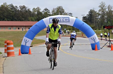 Dahlonega, GAUSA - SEPTEMBER 30: Unidentified man coming across the finish line at the Three and Six Gap Century ride, September 30, 2012 in Dahlonega GA.