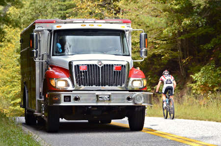 emergency call: Dahlonega, GAUSA- September 30: An EMT emergency firetruck on the way to help after getting a distress call, September 30, 2012, during a bicycle ride.