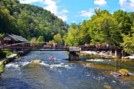 BRYSON CITY, NC, USA - SEPT 9: Rivers End Restaurant and bridge over the Nantahala River, Sept, 9, 2012. A popular tourist area for hiking and water sports in the Smoky Mountains.