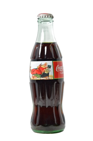 coke bottle: A Coke bottle from 1995 with a Christmas theme. Editorial