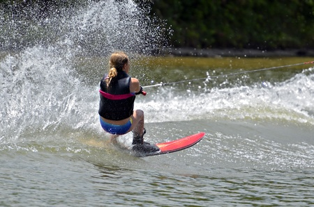A young girl on a slalom course during a competition  photo