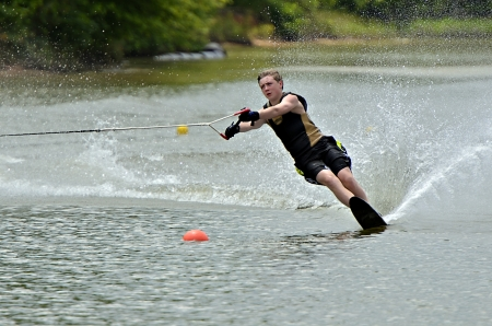 A young boy during a waterski competition  Stock Photo