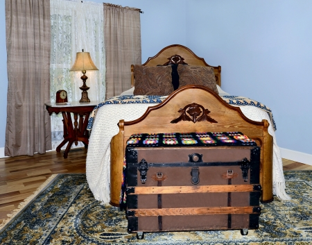 furnishings: Antique furnishings in a bedroom with hickory floors a chestnut bed and walnut table in the corner by a window