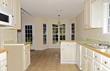 A view to the dining area from a small kitchen without a stove. Stock Photo