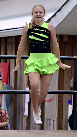 A beautiful young girl Irish dancing on an outdoor stage at a festival  photo