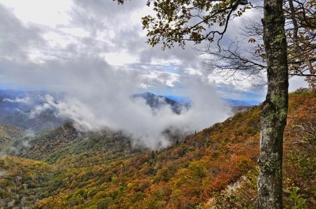 clouds making: Low Clouds Making a Ring Around a Mountain Peak Stock Photo