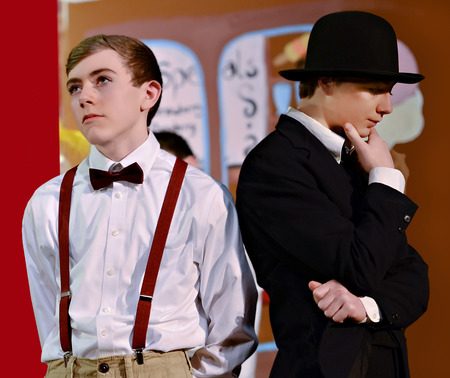 Two boys in period clothing during a school theater performance of The Music Man  North Forsyth High School, Feb  22, 2014