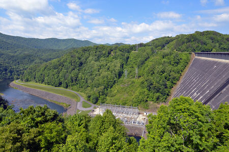 View of the Fontana Dam area and the river below   The Fontana Dam is the highest dam east of the Rocky Mountains  Towering 480 feet in height, the dam backs water for 30 miles and is a major source of energy for the Tennessee Valley