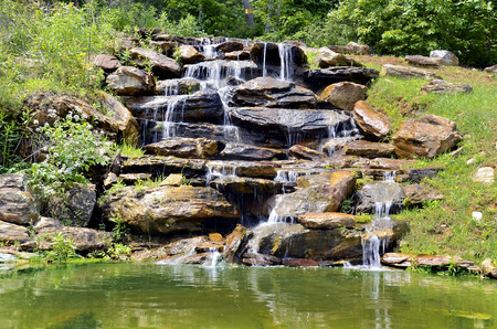 man made: A small natural looking, man made waterfall for a landscape design.