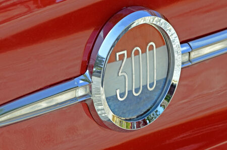 car detail: Detail on the side of a restored 1962 Chrysler 300.