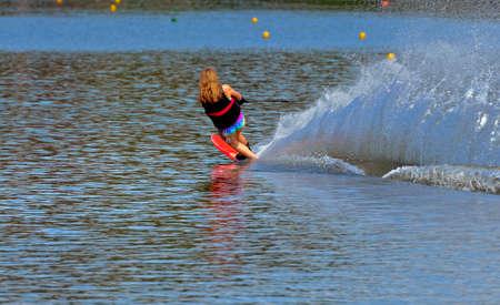 A preteen girl during a tournament skiing a slalom course  photo