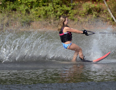 A preteen girl on a slalom course during a competition  photo