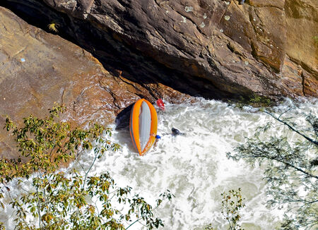 2 november: TALLULAH FALLS, GA, USA - NOVEMBER, 2- man in a capsized boat on the river rapids, November 2, 2014.