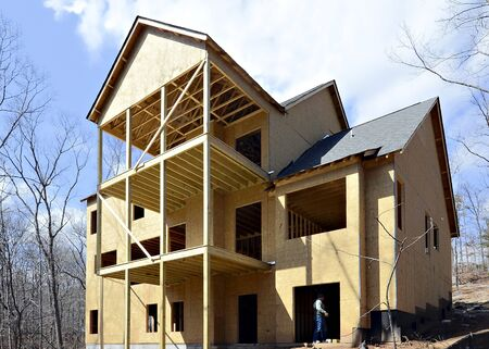 roofing system: The back of a new modern home showing the three levels of decking. Stock Photo