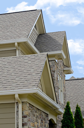 Close view of the a roof design on a modern home. Stock Photo
