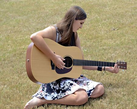 Teenage Girl Playing Guitar Stock Photo