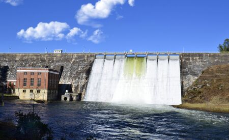 Water Release Over a Large Dam After a Storm Stock Photo