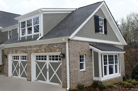 home exterior: Double door garage at the entry of a new modern home.