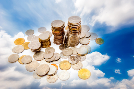 Coin, on the sky backdrop Stock Photo