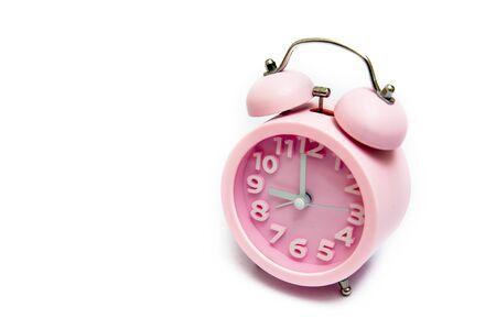 alarmclock: Pink alarm clock on a white background. Stock Photo