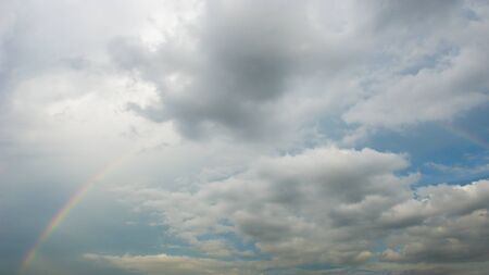 horisontal: Beautiful sky with clouds and rainbow Stock Photo
