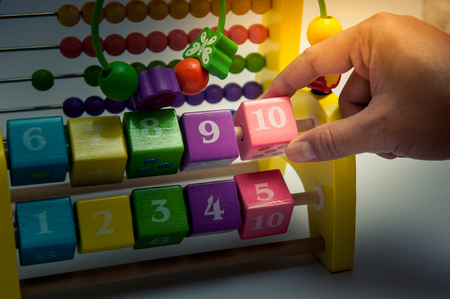 Wooden cubes with numbers, toys for the development of children Archivio Fotografico