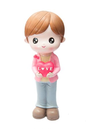 Doll holding heart expresses love. Stock Photo