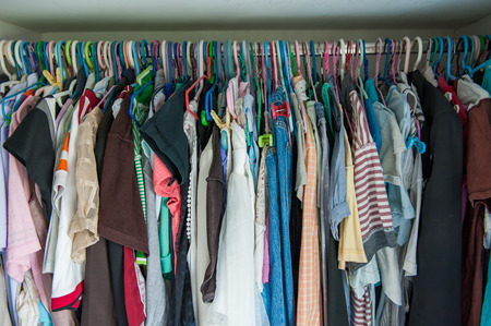 Many clothes in the Wardrobe at home. 免版税图像