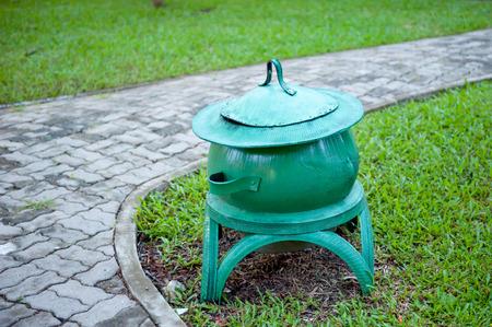 Green trash, strangely designed Not like anyone