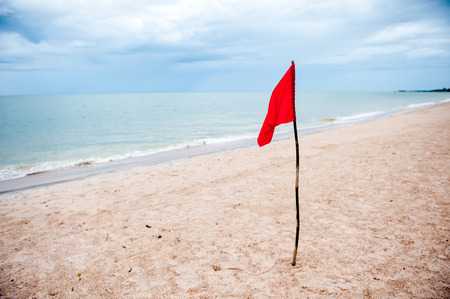 Red flag on the beach,Warning about the dangers. Stock Photo