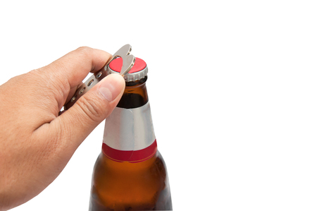 The bottle was opened by a man's hand, isolated against a white background. Stock Photo - 83083275