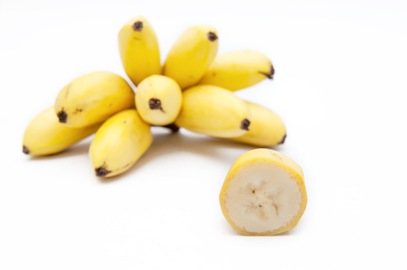 A bunch of bananas and its flesh on a white background.