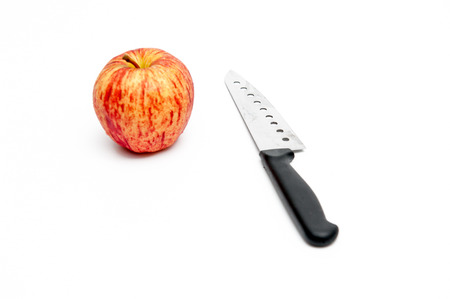 Fruit knife with apple red, with white background. Stock Photo