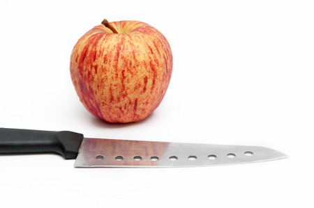 Red apples and fruit peel knife, with white ground. Stock Photo