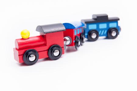 Toy train on white floor.