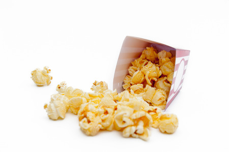 Popcorn in a box on a white background.