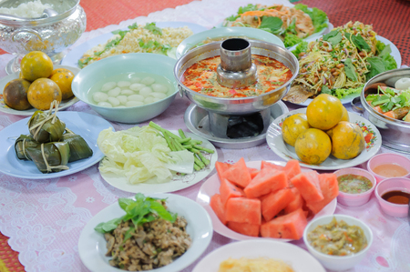 Food offerings to the Buddha, merit raising in Thailand.