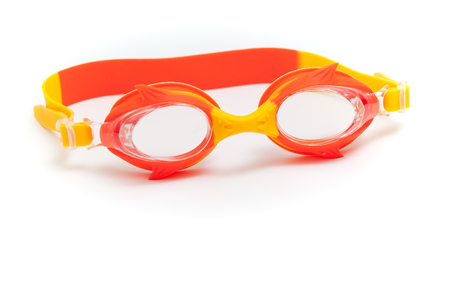 Red childrens swimming goggles on a white background.