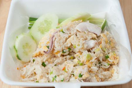 Fried rice with squid in foam box Фото со стока