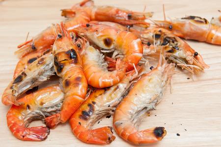 Grilled shrimp, fresh seafood, on wooden floor