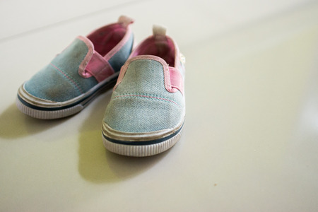 Baby shoes, placed on a beautiful floor Archivio Fotografico