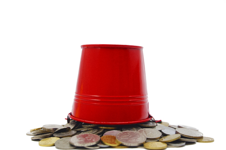 bucket spill out many coins over white backgrounds