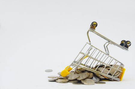 shopping cart with coins over white background Stock Photo