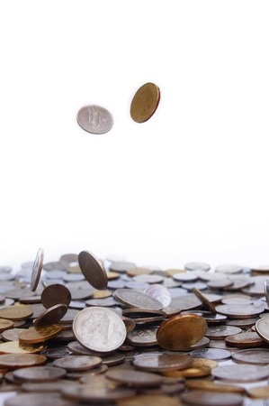 coins drop over white background