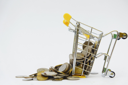 shopping cart flow many coins over white background