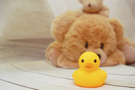 Front View Yellow Duck Toys Over Wooden Table Top Stock Photo ...