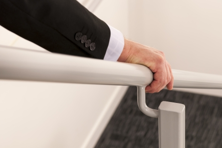 Handrail, guard rail, rail, hand, man, business attire, stairs, safety, careful, steel rail, indoors, emergency exit, going down, descending,  Railing, Human Hand, Holding, Gripping, Supporting, Human fingers, Close-up,  Selective Focus, Support, office b